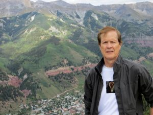Author and Boomer expert Brent Green standing above Telluride, Colorado